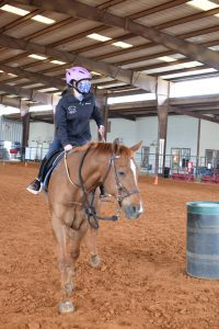 Sydney and Oakey going around a barrel