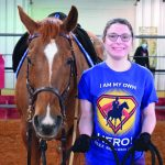 Sydney Middleton and Oakey, a brownish red horse